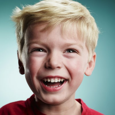 Young boy smiling with healthy teeth thanks to our childrens dentistry services in Edgewater NJ