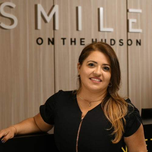 Carolina T. of Smiles on the Hudson dental practice in Edgewater, New Jersey